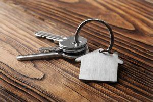 set of keys with house keychain